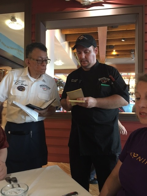The server and the chef speaking at The Boathouse Disney Springs